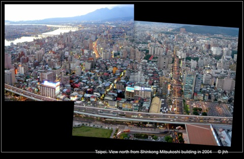 A few very large new buildings are replacing the small houses.  The old area of Taipei alongside the river.